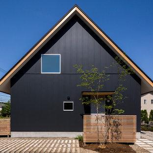 他の地域のアジアンスタイルのおしゃれな家の外観 (黒い外壁、切妻屋根、戸建) の写真