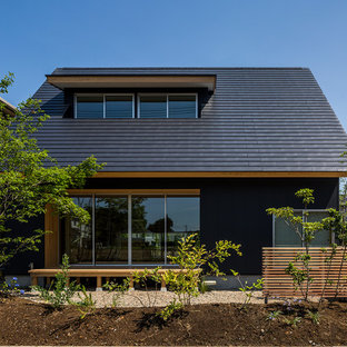 Asian black two-story exterior home photo in Other with a metal roof