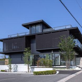 名古屋のコンテンポラリースタイルのおしゃれな家の外観 (黒い外壁、陸屋根) の写真