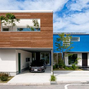 他の地域のミッドセンチュリースタイルのおしゃれな家の外観 (青い外壁) の写真