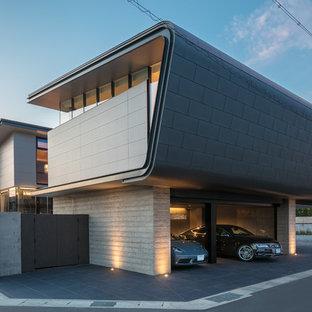 Ejemplo de fachada negra, moderna, con tejado plano