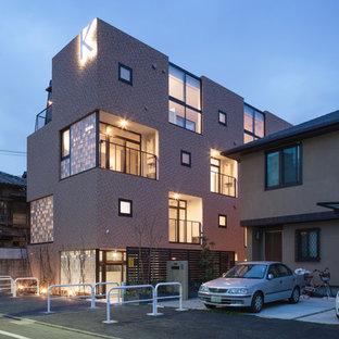 東京23区のコンテンポラリースタイルのおしゃれな家の外観 (ガラスサイディング、ベージュの外壁、アパート・マンション、混合材屋根) の写真