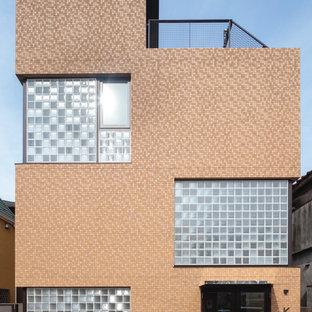 東京23区のコンテンポラリースタイルのおしゃれな陸屋根 (ガラスサイディング、ベージュの外壁、アパート・マンション、混合材屋根) の写真