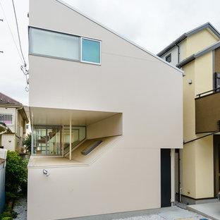 東京23区のコンテンポラリースタイルのおしゃれな家の外観 (ベージュの外壁) の写真