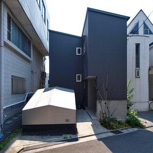 東京23区の小さいインダストリアルスタイルの二階建て住宅の画像 (片流れ屋根、グレーの外壁、戸建、金属屋根)