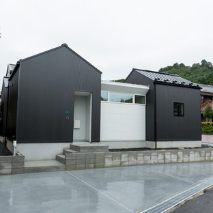 Example of a small danish white one-story metal exterior home design in Other with a metal roof