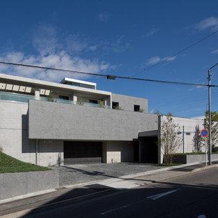 名古屋のコンテンポラリースタイルのおしゃれな陸屋根 (コンクリートサイディング、グレーの外壁) の写真
