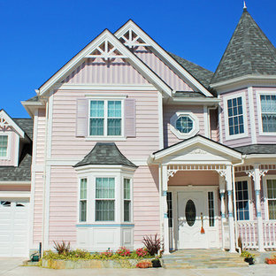 Idéer för vintage rosa hus, med två våningar och blandad fasad