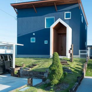 他の地域のコンテンポラリースタイルのおしゃれな家の外観 (青い外壁、陸屋根) の写真