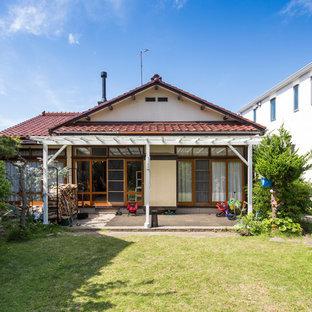 他の地域のトラディショナルスタイルのおしゃれな家の外観の写真