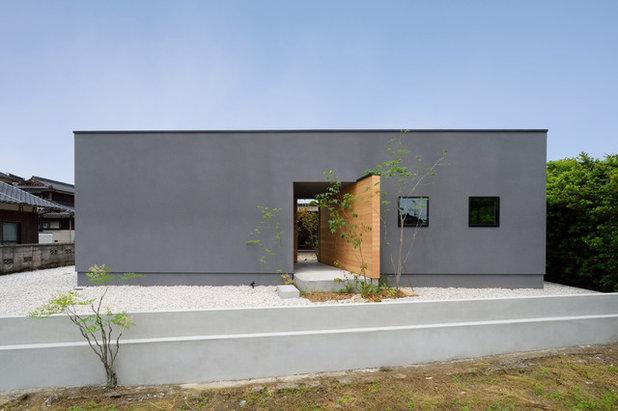 コンテンポラリー 家の外観 by 株式会社I.D.Works