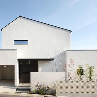 他の地域のモダンスタイルのおしゃれな家の外観 (漆喰サイディング) の写真