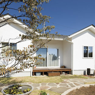Danish white one-story stucco exterior home photo in Other