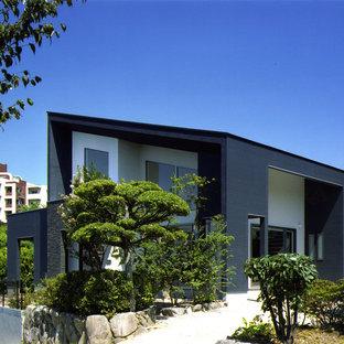 福岡のモダンスタイルのおしゃれな陸屋根の家 (黒い外壁) の写真