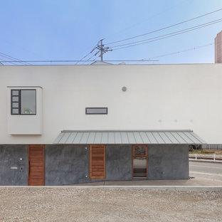 名古屋の小さいアジアンスタイルのおしゃれな家の外観 (混合材サイディング、混合材屋根) の写真