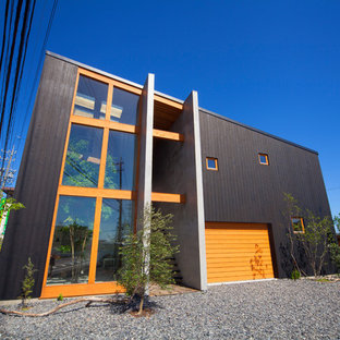 Large black two-story wood exterior home photo in Nagoya with a shed roof