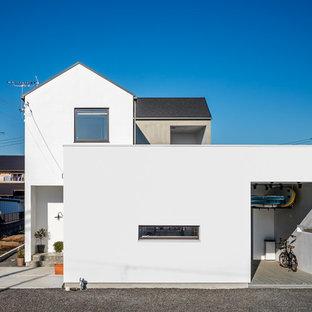 他の地域のアジアンスタイルのおしゃれな白い家の写真