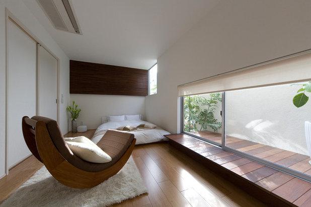 Asian Bedroom by 富国ハウジング&KADeL