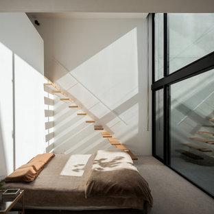 名古屋のコンテンポラリースタイルのおしゃれな寝室 (白い壁、グレーの床) のインテリア