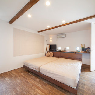 Inspiration for an asian bedroom in Other with white walls and brown floor.