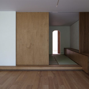 Inspiration for an asian master tatami floor bedroom remodel in Tokyo with white walls