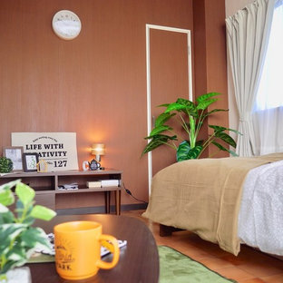 Small bedroom in Osaka with brown walls and orange floor.