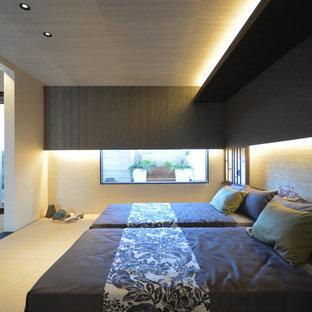 Immagine di una camera matrimoniale etnica con pareti nere