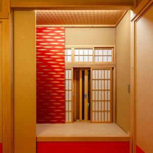 Imagen de habitación de invitados de estilo zen, de tamaño medio, sin chimenea, con paredes rojas, tatami y suelo rojo
