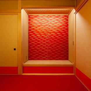 Diseño de habitación de invitados de estilo zen, de tamaño medio, sin chimenea, con paredes rojas, tatami y suelo rojo