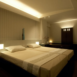 Inspiration for a large modern master bedroom in Other with white walls, dark hardwood floors, black floor and recessed.
