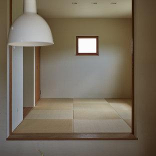 Mid-sized zen guest tatami floor and beige floor bedroom photo in Other with white walls