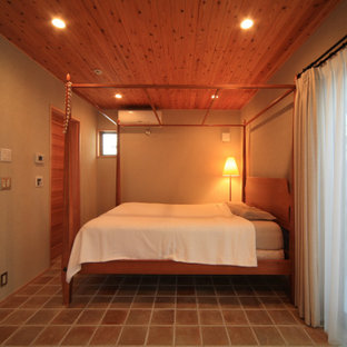 Midcentury master bedroom in Nagoya with beige walls, terra-cotta floors, beige floor and wood.