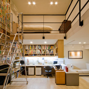 Photo of a traditional loft-style bedroom in Tokyo with white walls.