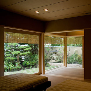This is an example of an asian bedroom in Other.
