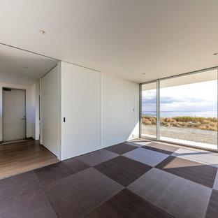 Bedroom - mid-sized modern guest tatami floor and gray floor bedroom idea in Other