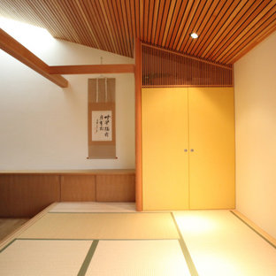 This is an example of a mid-sized asian guest bedroom in Other with brown walls, tatami floors, no fireplace, beige floor and wood.