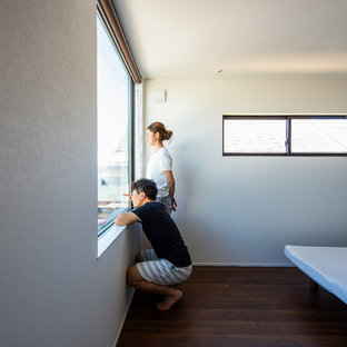 Minimalist master plywood floor bedroom photo in Other with white walls