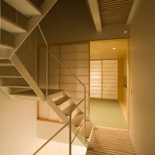 Photo of a modern master bedroom in Tokyo with tatami floors.