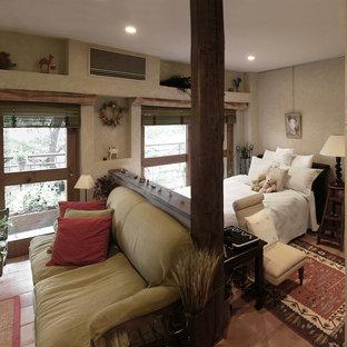 Country bedroom in Tokyo with white walls, terra-cotta floors and orange floor.