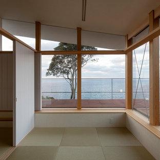 Example of a minimalist guest tatami floor and green floor bedroom design in Other with beige walls