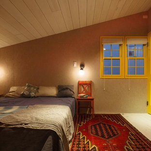 This is an example of a beach style loft-style bedroom in Other with multi-coloured walls.