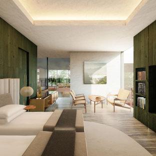 Imagen de dormitorio principal y machihembrado, minimalista, grande, machihembrado, con paredes verdes, suelo de piedra caliza, suelo gris y machihembrado