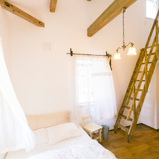 Design ideas for a small mediterranean loft-style bedroom in Fukuoka with purple walls, dark hardwood floors and brown floor.