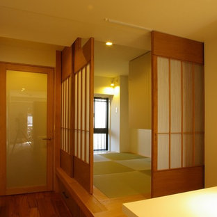 Modern master bedroom in Other with white walls, tatami floors and beige floor.