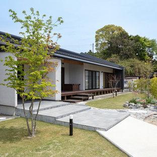他の地域のアジアンスタイルのおしゃれな庭 (日向、コンクリート敷き、私道) の写真