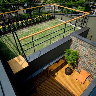 Foto di un giardino minimalista esposto in pieno sole di medie dimensioni e sul tetto in estate con un giardino in vaso