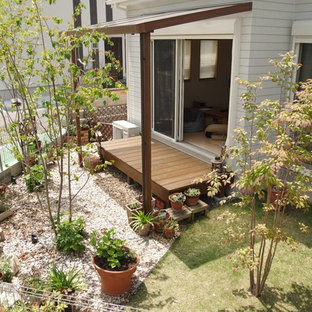 他の地域の中くらいの、夏のアジアンスタイルのおしゃれな中庭 (日向、レンガ敷き) の写真