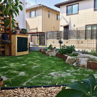 他の地域の中サイズの、夏のアジアンスタイルのおしゃれな中庭 (日向、レンガ敷き) の写真