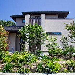 他の地域のアジアンスタイルのおしゃれな前庭 (日向、天然石敷き) の写真