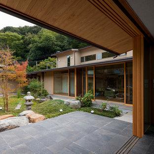 他の地域の秋のアジアンスタイルのおしゃれな中庭の写真
